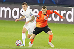 Real Madrid's Toni Kroos (l) and FC Shakhtar Donetsk's Davit Khocholava during UEFA Champions League match. October 20,2020.(ALTERPHOTOS/Acero)