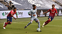 KANSAS CITY, KS - SEPTEMBER 19: Bryan Acosta #8 and Bryan Reynolds #14 of FC Dallas look on as Amadou Dia #13 of Sporting Kansas City passes the ball outside the box during a game between FC Dallas and Sporting Kansas City at Children's Mercy Park on September 19, 2020 in Kansas City, Kansas.