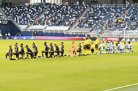 KANSAS CITY, KS - OCTOBER 11: Sporting KC and Nashville SC players show their support for Black Lives Matter by taking a knee prior to the start of the match during a game between Nashville SC and Sporting Kansas City at Children's Mercy Park on October 11, 2020 in Kansas City, Kansas.