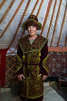 Mongolia, Bayan-Ulgii, Ulgii, Altai Mountains.Our driver, near Tsambagarav Mountain in traditional clothing.