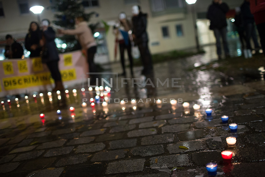 At a demonstration for the rights of Parisian Chinese sex workers, candles arranged in the shape of a heart at Place Jean Rostand on the Day to End Violence Against Sex Workers. Chinese sex workers in Paris, who are usually here without legal papers, often experience violence and harassment on the streets from clients and even police. Paris, France. Dec. 17, 2014