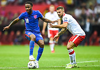 8th September 2021; PGE National Stadium, Warsaw, Poland: FIFA World Cup 2022 Football qualification, Poland versus England;  Raheem Sterling pulls the ball back to control in front of Karol Linetty