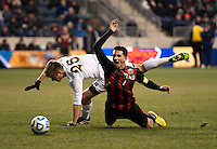 Dan Metzger (7) of Maryland is fouled by Brandon Aubrey (25) of Notre Dame  during the NCAA Men's College Cup final at PPL Park in Chester, PA.  Notre Dame defeated Maryland, 2-1.