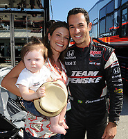 HOMESTEAD, FL - OCTOBER 01: (EXCLUSIVE COVERAGE)  Helio Castroneves of Brazil driver of the #3 Team Penske Dallara Honda  with his girlfriend Adriana Henao and their baby Mikaella during final practice for the IndyCar Series Cafes do Brasil Indy 300 at Homestead-Miami Speedway on October 1, 2010 in Homestead, Florida<br /> <br /> <br /> People:  Helio Castroneves_Adriana Henao_Mikaella