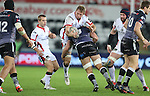 Ulster number 8 Roger Wilson gets knocked back in the tackle by his opposite number Tyler Ardron.<br /> Guiness Pro12<br /> Ospreys v Ulster<br /> 20.12.14<br /> ©Steve Pope -SPORTINGWALES