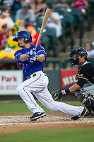 Round Rock Express second baseman Brent Lillibridge (18) follows through on his swing during the Pacific Coast League baseball game against the Omaha Storm Chasers on June 1, 2014 at the Dell Diamond in Round Rock, Texas. The Express defeated the Storm Chasers 11-4. (Andrew Woolley/Four Seam Images)