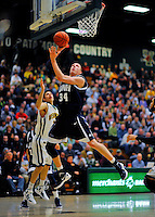 29 January 2012: University of New Hampshire Wildcat forward Brian Benson, a Senior from Rochester, NY, in action against the University of Vermont Catamounts at Patrick Gymnasium in Burlington, Vermont. The Catamounts defeated the Wildcats 77-60 in America East play. Mandatory Credit: Ed Wolfstein Photo