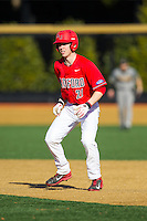 Jordan Taylor (21) of the Radford Highlanders takes his lead off of first base against the Missouri Tigers at Wake Forest Baseball Park on February 21, 2014 in Winston-Salem, North Carolina.  The Tigers defeated the Highlanders 15-3.  (Brian Westerholt/Four Seam Images)