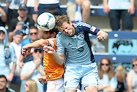 Mike Chabala (6) defender Houston Dynamo goes up for a header with Jacob Peterson (37) Sporting KC.Sporting Kansas City and Houston Dynamo played to a 1-1 tie at Sporting Park, Kansas City, Kansas.