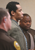 Sniper suspect John Allen Muhammad stands as he listens to the guilty verdicts on four charges in courtroom 10 at the Virginia Beach Circuit Court in Virginia Beach, Virginia on November 17, 2003. Muhammad was found guilty of capitol murder, terrorism, conspiracy and a firearms violation. <br /> Credit: Dave Ellis - Pool via CNP