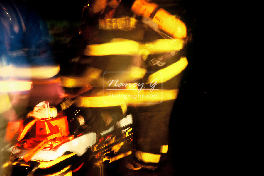 EMS personnel are removing an injured victim on a stretcher