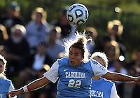 SAN DIEGO, CA - DECEMBER 02, 2012:  Amber Brooks (22) of the University of North Carolina heads against Penn State University during the NCAA 2012 women's college championship match, at Torero Stadium, in San Diego, CA, on Sunday, December 02 2012. Carolina won 4-1.
