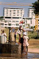 June 1975, Lourencio Marques (now Maputo), Mozambique. With no regular distribution of water, children from the poor areas around the city are sent to small fountains to carry water for their families.
