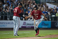 Daniel Amaral (6) of the Altoona Curve slaps hands with third base coach Miguel Perez (29) after hitting a home run against the Somerset Patriots at TD Bank Ballpark on July 24, 2021, in Somerset NJ. (Brian Westerholt/Four Seam Images)