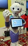 July 20, 2016, Tokyo, Japan - Softbank's humanoid robot Pepper wears wrapping sticker for his clothes designed by iJet at a press preview of the Pepper World exhibition in Tokyo on Wednesday, July 20, 2016. Pepper's latest applications and accessories will be exhibited at the Pepper World robot exhibition on July 21 and 22.      (Photo by Yoshio Tsunoda/AFLO)