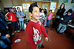 A boy clowns around in a class in the Branko Pesic School, an educational center for Roma children and families in Belgrade, Serbia, which is supported by Church World Service. Many of the students' families came to Belgrade as refugees from Kosovo. Many of them lack legal status in Serbia, and thus have difficulty obtaining formal employment and accessing government services.