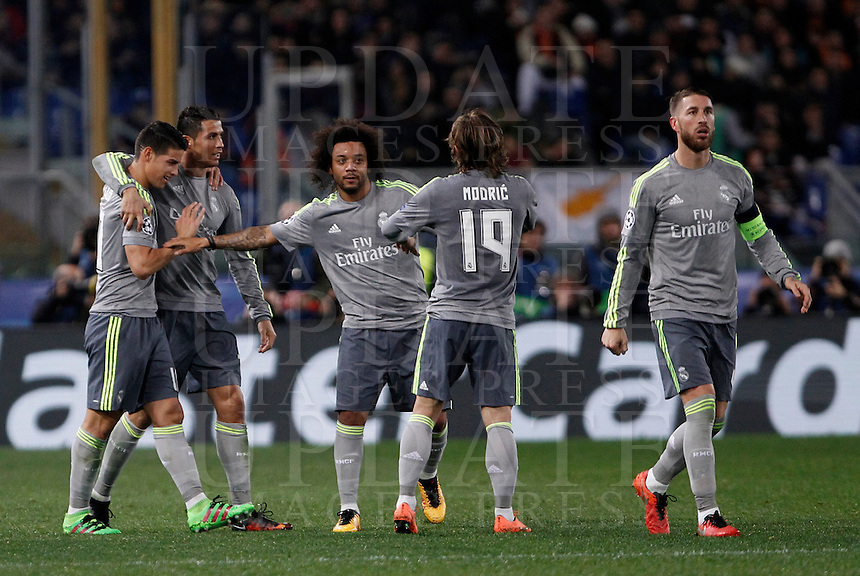 Calcio, andata degli ottavi di finale di Champions League: Roma vs Real Madrid. Roma, stadio Olimpico, 17 febbraio 2016.<br /> Real Madrid's Cristiano Ronaldo, second from left, celebrates with teammates after scoring after scoring during the first leg round of 16 Champions League football match between Roma and Real Madrid, at Rome's Olympic stadium, 17 February 2016.<br /> UPDATE IMAGES PRESS/Isabella Bonotto