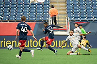 FOXBOROUGH, MA - APRIL 17: Christian Malfa #38 of New England Revolution II passes the ball as Hernan Gonzalez #19 of Richmond Kickers comes in for a tackle during a game between Richmond Kickers and Revolution II at Gillette Stadium on April 17, 2021 in Foxborough, Massachusetts.