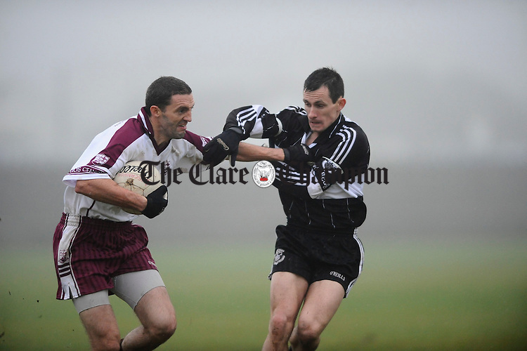 Liscannors Kieran Considine is tackled by Doonbeg's Richie Vaughan during their semi final at Miltown Malbay. Photograph by John Kelly.