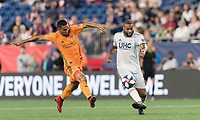 FOXBOROUGH, MA - JUNE 29: Andrew Farrell #2 passes the ball as Mauro Manotas #9 closes during a game between Houston Dynamo and New England Revolution at Gillette Stadium on June 29, 2019 in Foxborough, Massachusetts.