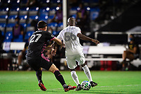 LAKE BUENA VISTA, FL - JULY 27: Shane O'Neill #27 of the Seattle Sounders and Bradley Wright-Phillips #66 of LAFC battle for the ball during a game between Seattle Sounders FC and Los Angeles FC at ESPN Wide World of Sports on July 27, 2020 in Lake Buena Vista, Florida.