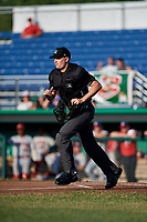Home plate umpire Sean Cassidy during a game between the Auburn Doubledays and the Batavia Muckdogs on June 28, 2018 at Dwyer Stadium in Batavia, New York.  Auburn defeated Batavia 14-9.  (Mike Janes/Four Seam Images)