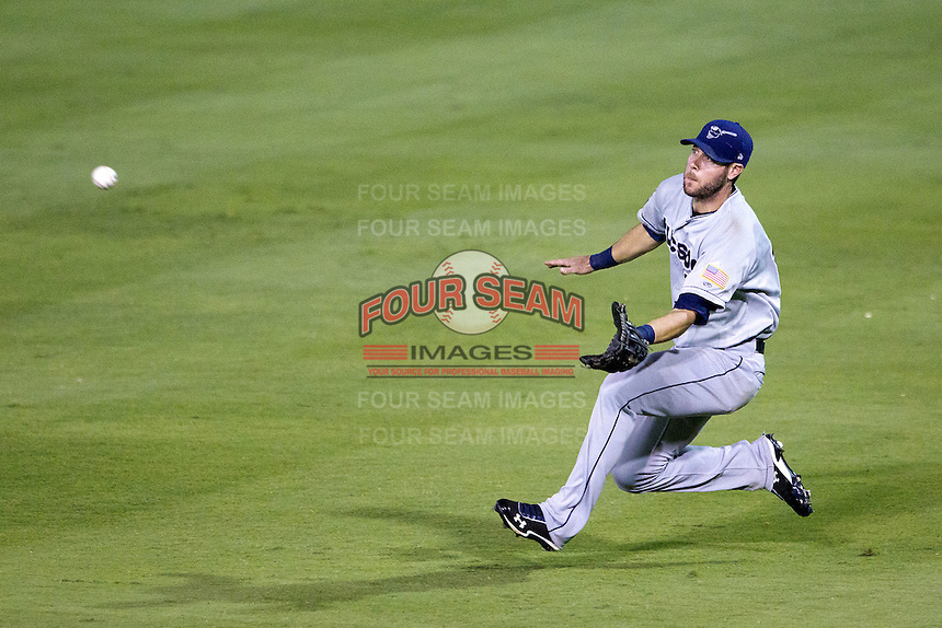 Tucson Padres outfielder Jeremy Hermida #18 makes a diving catch during the Pacific Coast League baseball game against the Round Rock Express on August 4th, 2012 at the Dell Diamond in Round Rock, Texas. The Padres defeated the Express 10-6. (Andrew Woolley/Four Seam Images).