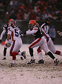 December 16th, 2007:  Cleveland Browns Chaun Thompson (51) attempts to block Buffalo Bills Linebacker Blake Costanzo (54) at Cleveland Browns Stadium in Cleveland, Ohio.  The Browns shutout the Bills 8-0 to inch closer to clinching a playoff spot.  Photo Copyright Mike Janes Photography.
