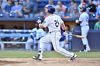 Asheville Tourists first baseman Chad Spanberger (24) swings at a pitch during a game against the Greensboro Grasshoppers at McCormick Field on May 10, 2018 in Asheville, North Carolina. The Tourists defeated the Grasshoppers 14-10. (Tony Farlow/Four Seam Images)