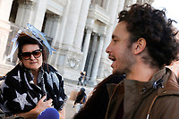 A 'sardina' listen to Mattia Santori, one of the founders of the movement, making an interview<br /> Rome December 14th 2019. Gathering of the movement od the sardine (sardines), born to protest against Salvini's Lega party that have filled St Giovanni Square<br /> Foto Samantha Zucchi Insidefoto