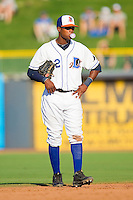 Shortstop Tim Beckham #22 of the Durham Bulls blows a bubble between pitches during the first game of a double header against the Charlotte Knights at Durham Bulls Athletic Park on August 28, 2011 in Durham, North Carolina.   (Brian Westerholt / Four Seam Images)
