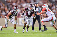 Texas A&M defensive back Sam Moeller (12) and defensive back Floyd Raven Sr. (5) rush to block a punt during NCAA Football game, Saturday, September 06, 2014 in College Station, Tex. Texas A M defeated Lamar 73-3. (Mo Khursheed/TFV Media via AP Images)