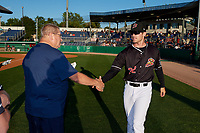 Batavia Muckdogs Brock Love (32) shakes hands with Booster Club President Hal Mitchell during a pre-game awards ceremony before a NY-Penn League game against the Auburn Doubledays on August 31, 2019 at Dwyer Stadium in Batavia, New York.  Auburn defeated Batavia 12-5.  (Mike Janes/Four Seam Images)