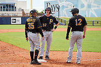 FCL Pirates Black Henry Davis (32) talks with manager Stephen Morales (35) and Dustin Fowler (12) during a pitching change in the top of the third inning during a game against the FCL Rays on August 3, 2021 at Charlotte Sports Park in Port Charlotte, Florida.  Davis was making his professional debut after being selected first overall in the MLB Draft out of Louisville by the Pittsburgh Pirates.  (Mike Janes/Four Seam Images)