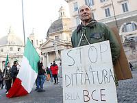 """Manifestazione del Movimento dei Forconi contro le politiche di austerita' del governo, le tasse e la disoccupazione, in Piazza del Popolo a Roma, 18 dicembre 2013.<br /> Pitchforks Movement's protesters gather against government's austerity measures, taxes and unemployment in Rome, 18 December 2013. The sign reads """"Stop to ECB dictatorship"""".<br /> UPDATE IMAGES PRESS/Riccardo De Luca"""