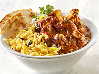 Chicken Madras, pilau rice & popodoms. Indian traditional curry.