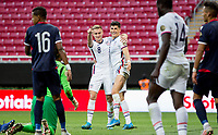 ZAPOPAN, MEXICO - MARCH 21: Djordje Mihailovic #8 and Sebastian Soto #19 of the United States celebrate during a game between Dominican Republic and USMNT U-23 at Estadio Akron on March 21, 2021 in Zapopan, Mexico.