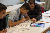 Sprachunterricht fuer Fluechtlinge bei der Handwerkskammer in Cottbus.<br /> In Zusammenarbeit mit dem regionalen Jobcenter, Fluechtlingshilfen und zustaendigen Behoerden versucht die Handwerkskammer Fluechtlingen eine Perspektive fuer Fluechtlinge zu schaffen. Zwischen bis zu 20 Fluechtlinge aus Eritrea, Afgahnistan, Syrien und Pakistan lernen hier Deutsch und bekommen die Moeglichkeit sich ueber die ausserbetrieblichen Ausbildungsmoeglichkeiten zu informieren oder bei Firmenbesuchen einen Ausbildungsplatz suchen.<br /> Entstanden ist diese Initiative der Handwerkskammer Cottbus aufgrund der geringen Zahl an Auszubildenden. Zu viele junge Menschen verlassen die Region. Dies bereitet den Handwerksbetrieben grosse Probleme.<br /> Im Bild vlnr.: Die Fluechtlinge Asghar, Ahmed und Najib aus Afghanistan.<br /> 11.11.2015, Cottbus<br /> Copyright: Christian-Ditsch.de<br /> [Inhaltsveraendernde Manipulation des Fotos nur nach ausdruecklicher Genehmigung des Fotografen. Vereinbarungen ueber Abtretung von Persoenlichkeitsrechten/Model Release der abgebildeten Person/Personen liegen nicht vor. NO MODEL RELEASE! Nur fuer Redaktionelle Zwecke. Don't publish without copyright Christian-Ditsch.de, Veroeffentlichung nur mit Fotografennennung, sowie gegen Honorar, MwSt. und Beleg. Konto: I N G - D i B a, IBAN DE58500105175400192269, BIC INGDDEFFPakistan, Kontakt: post@christian-ditsch.de<br /> Bei der Bearbeitung der Dateiinformationen darf die Urheberkennzeichnung in den EXIF- und  IPTC-Daten nicht entfernt werden, diese sind in digitalen Medien nach §95c UrhG rechtlich geschuetzt. Der Urhebervermerk wird gemaess §13 UrhG verlangt.]