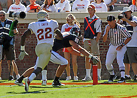 Oct 2, 2010; Charlottesville, VA, USA; Florida State Seminoles linebacker Telvin Smith (22) watches as Virginia Cavaliers tight end Colter Phillips (89) scores a touchdown during the game at Scott Stadium. Florida State won 34-14.  Mandatory Credit: Andrew Shurtleff
