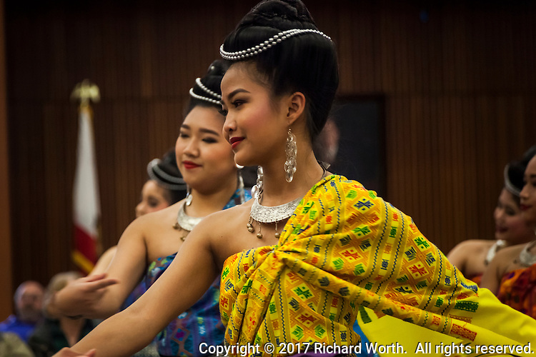 Jewelry adorns the hair, ears and necks of dancers in traditional costumes at a Lunar New Year celebration.