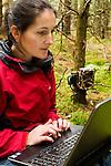 Scottish Wildcat (Felis silvestris grampia) biologist, Kerry Kilshaw, looking at camera trap images, Scotland, United Kingdom