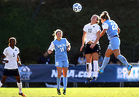 SAN DIEGO, CA - DECEMBER 02, 2012:  Amber Brooks (22) of the University of North Carolina goes up for a header with Christine Nairn (10) of Penn State University during the NCAA 2012 women's college championship match, at Torero Stadium, in San Diego, CA, on Sunday, December 02 2012. Carolina won 4-1.