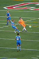 Heather O'Reilly (9) of Sky Blue FC plays the ball away from Kristine Lilly (13) of the Boston Breakers. Sky Blue FC defeated the Boston Breakers 2-1 during a WPS regular season match at Harvard Stadium in Boston, MA, on July 12, 2009.