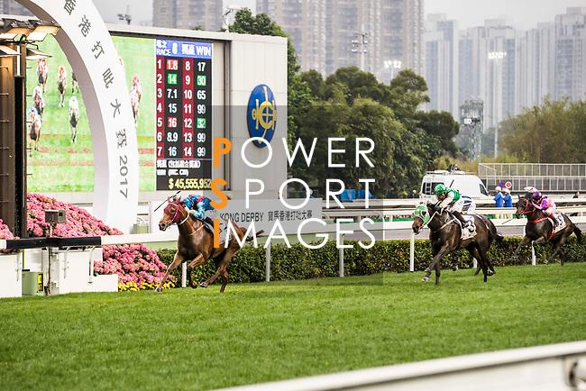 Jockey Joao Moreira riding Rapper Dragon (l) wins the 2017 BMW Hong Kong Derby Race at the Sha Tin Racecourse on 19 March 2017 in Hong Kong, China. Photo by Marcio Rodrigo Machado / Power Sport Images