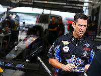 Aug 30, 2014; Clermont, IN, USA; NHRA top fuel dragster driver Larry Dixon signing autographs during qualifying for the US Nationals at Lucas Oil Raceway. Mandatory Credit: Mark J. Rebilas-USA TODAY Sports