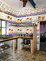 The walls of this spectacular kitchen are lined with ceramic tiles.  While practical, the kitchen has a gas hob, but no oven and the fridge is to be found in one of the bedrooms, where there is a supply of electricity