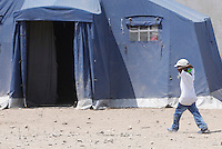 Un bambino nella tendopoli allestita per i migranti presso la stazione Tiburtina a Roma, 16 giugno 2015.<br /> A child walks in the tent camp set up near the Tiburtina railway station in Rome, 15 June 2015. Italy is facing a huge flow of migrants brought to Sicily after rescue at sea, many of whom are trying to join their relatives in northern Europe. <br /> UPDATE IMAGES PRESS/Riccardo De Luca