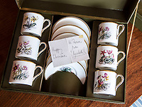 BNPS.co.uk (01202 558833)<br /> Pic: PhilYeomans/BNPS<br /> <br /> Porcelein tea set Christmas gift sent from the Queen.<br /> <br /> A remarkable 'time warp' Royal archive amassed by the Queen's dressmaker has been found inside his old country home.<br /> <br /> The late Ian Thomas was a dress designer for members of the Royal Family, including Her Majesty, for over 30 years.<br /> <br /> As an apprentice he worked alongside the renowned fashion designer Norman Hartnell on creating the Queen's coronation dress in 1953.<br /> <br /> His archive includes embroidered samples of the gown worn by Elizabeth II for the historic ceremony in Westminster Abbey that was broadcast to millions.<br /> <br /> Mr Thomas also designed outfits for the Queen Mother and Princess Margaret.