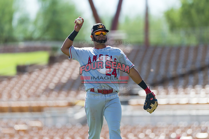 Mesa Solar Sox third baseman Roberto Baldoquin (24), of the Los Angeles Angels organization, throws a ball to the dugout during an Arizona Fall League game against the Glendale Desert Dogs at Camelback Ranch on October 15, 2018 in Glendale, Arizona. Mesa defeated Glendale 8-0. (Zachary Lucy/Four Seam Images)