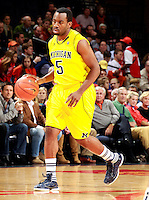 CHARLOTTESVILLE, VA- NOVEMBER 29: Eso Akunne #5 of the Michigan Wolverines handles the ball during the game on November 29, 2011 at the John Paul Jones Arena in Charlottesville, Virginia. Virginia defeated Michigan 70-58. (Photo by Andrew Shurtleff/Getty Images) *** Local Caption *** Eso Akunne